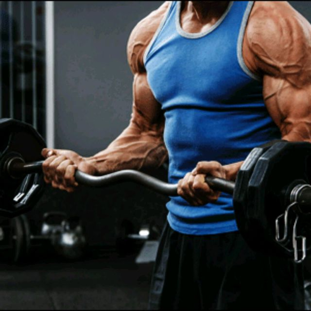 bodybuilder using STATIC HOLDS for bicep training